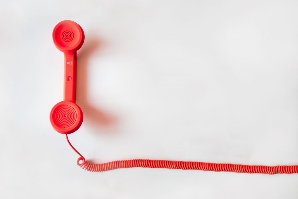 old-school red phone on white background