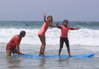 girls surfing in del mar aqua adventures surf camp