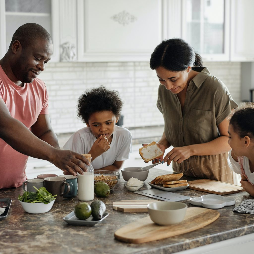 family preparing a healthy meal together